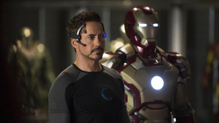"This undated publicity image released by Marvel shows Robert Downey Jr., as Tony Stark/Iron Man, in a scene from ""Marvel's Iron Man 3.""  ""Marvel's Iron Man 3"" was one of several upcoming films to receive spotlight treatment with an ad that aired during Super Bowl XLVII on Sunday, Feb. 3, 2013. (AP Photo/Marvel, Zade Rosenthal)"