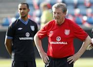 """England manager Roy Hodgson (right) supervises a training session in Oslo on May 25. Hodgson has repeatedly emphasised that he needs time to put his imprint on the squad after being """"parachuted"""" into the demanding job"""