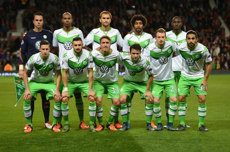 Wolfsburg's team poses ahead of a UEFA Champions League Group B football match against Manchester United at Old Trafford in Manchester on September 30, 2015
