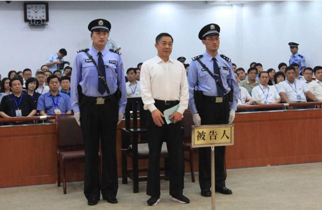 Ousted Chinese politician Bo listens to his verdict inside the Jinan Intermediate People's Court in Jinan