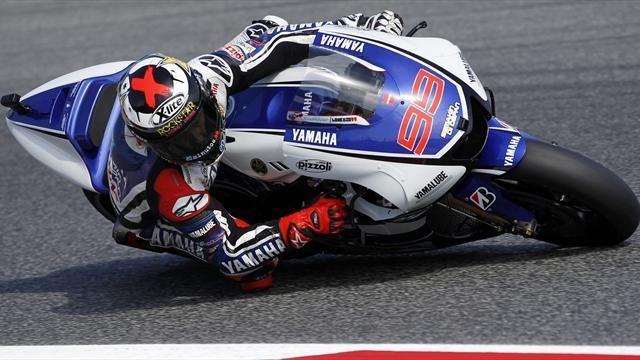 Stoner beats Lorenzo in US to narrow title gap