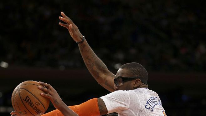 New York Knicks' Amar'e Stoudemire, right, fouls Cleveland Cavaliers' Tristan Thompson during the second half of the NBA basketball game at Madison Square Garden, Sunday, March 23, 2014, in New York. The Cavaliers defeated the Knicks 106 to 100