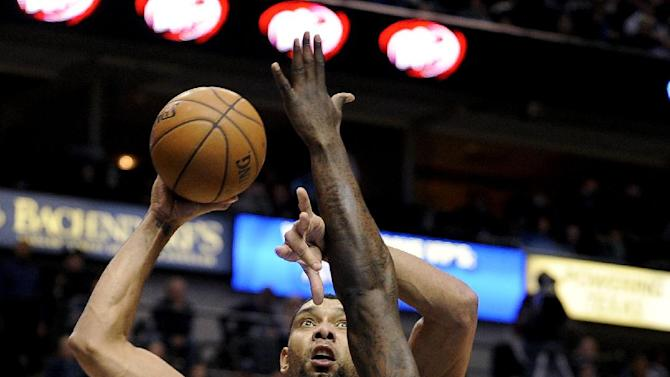 San Antonio Spurs forward Tim Duncan (21) shoots over Dallas Mavericks center DeJuan Blair (45) during the first half of an NBA basketball game, Thursday, Dec. 26, 2013, in Dallas