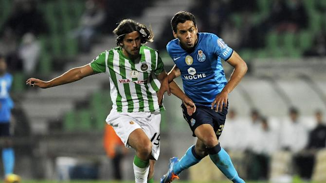 FC Porto's Carlos Eduardo, from Brazil, challenges Rio Ave's Tiago Pinto, left, in a Portuguese League soccer match, in Vila do Conde, northern Portugal, Sunday, Dec. 15, 2013