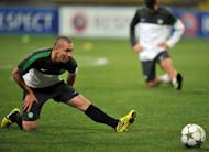 Celtic's Scott Brown stretches during a training session in Moscow, on October 1, 2012. Brown is confident his side can continue their Scottish Premier League winning run as they prepare to take on Hibernian at Easter Road on Saturday and then look ahead to enjoying the winter break