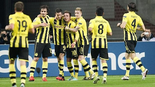Borussia Dortmund celebrates a goal against Ajax Amsterdam during their Champions League Group D match in Amsterdam