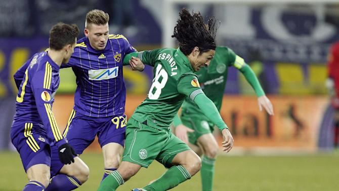 Wigan's Roger Espinoza, right, is challenged by Maribor's Matic Crnic during their group D Europa League soccer match, in Maribor, Slovenia, Thursday, Dec. 12, 2013