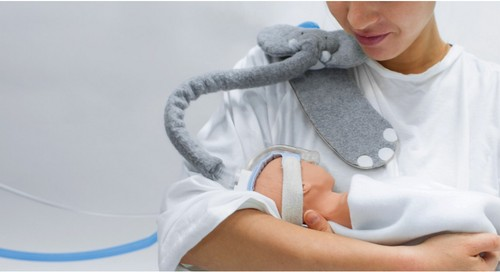 Woman holding doll wearing Trompe