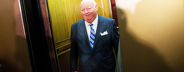 Sen. Mike Duffy takes the elevator as he arrives to the Senate on Parliament Hill in Ottawa on Monday, October 28, 2013. THE CANADIAN PRESS/Sean Kilpatrick