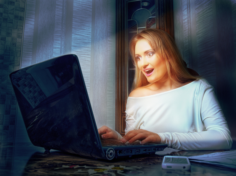 business woman looking at the screen of his laptop and admires