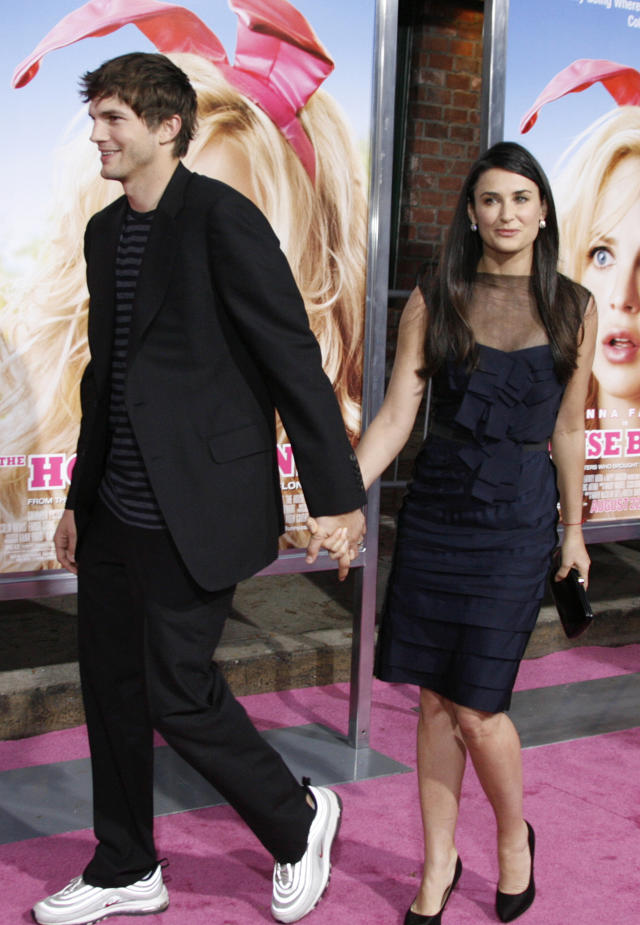 Actress Demi Moore and her husband actor Ashton Kutcher arrive for the premiere of