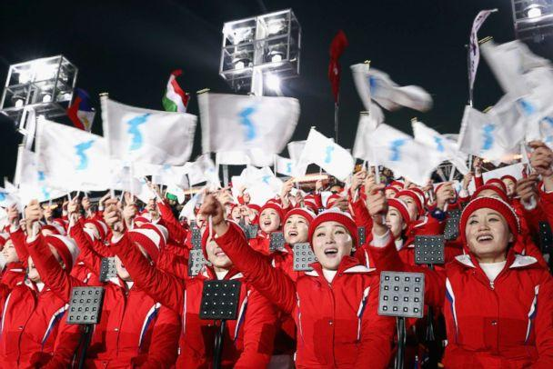PHOTO: Members of the North Korean cheerleader squad sing and wave flags prior to the Opening Ceremony of the 2018 Winter Olympic Games in Pyeongchang, South Korea, Feb. 9, 2018. (Maddie Meyer/Getty Images)