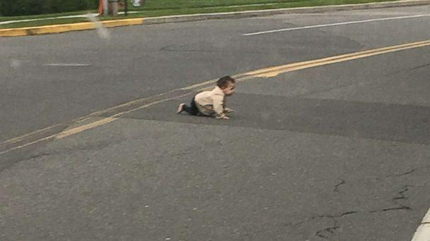 PHOTO: A baby crawls across Joe Parker Road in Lakewood Township, N.J., in a photo taken by a passing motorist who stopped to move the child off of the street. (Courtesy Cory Cannon)