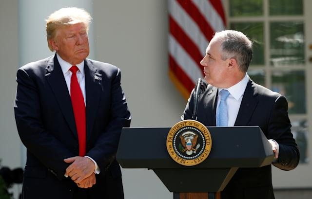 President Donald Trump listens to Scott Pruitt in the White House Rose Garden after announcing his decision to leave the Paris agreement in June 2017.  (Kevin Lamarque/Reuters)