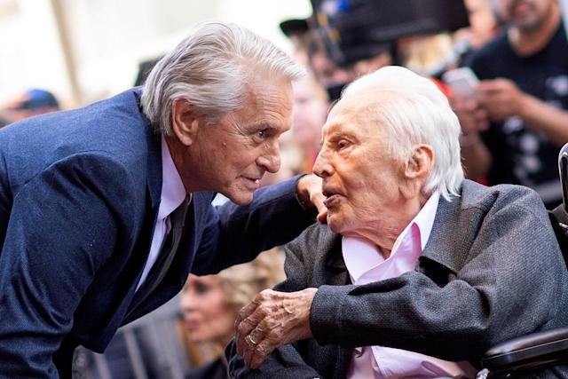Spartacus star Kirk Douglas (right) pictured with his son, Michael Douglas, in 2018: AFP via Getty Images