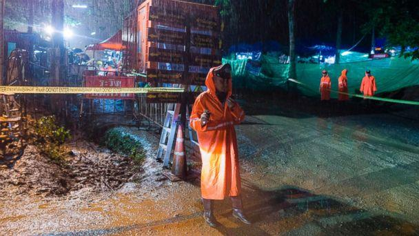 PHOTO: A Thai policeman guards an area under rainfall near the Tham Luang cave at the Khun Nam Nang Non Forest Park in Mae Sai district of Chiang Rai province, July 7, 2018, as rescue operation continues for the 12 boys and their football team coach. (Ye Aung Thu/AFP/Getty Images)