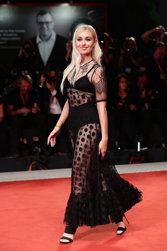 Another guest at The King red carpet in a racy black design. Photo: Getty