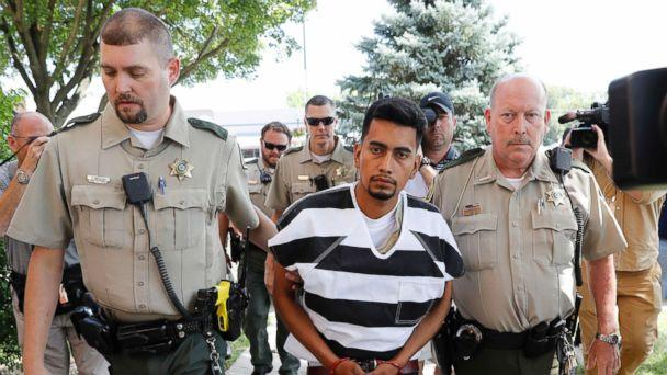 PHOTO: Cristhian Rivera is escorted into the Poweshiek County Courthouse for his initial court appearance, Aug. 22, 2018, in Montezuma, Iowa. (Charlie Neibergall/AP)