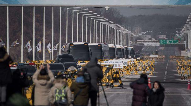 PHOTO: Busses carrying a 280-member delegation of North Korean cheerleaders crosses a checkpoint on Tongil bridge after arriving in South Korea, in Paju on February 7, 2018. (Ed Jones/AFP/Getty Images)
