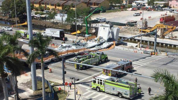 PHOTO: Emergency personnel responds to a collapsed pedestrian bridge connecting Florida International University on March 15, 2018 in the Miami area. The brand-new pedestrian bridge collapsed onto a highway crushing at least five vehicles. (Roberto Koltun/The Miami Herald via AP)