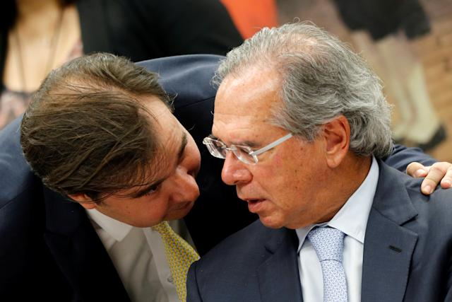 Brazil's Lower House President Rodrigo Maia talks with Brazil's Economy Minister Paulo Guedes during a session of the commission of the pension reform bill at the National Congress in Brasilia, Brazil May 8, 2019. REUTERS/Adriano Machado