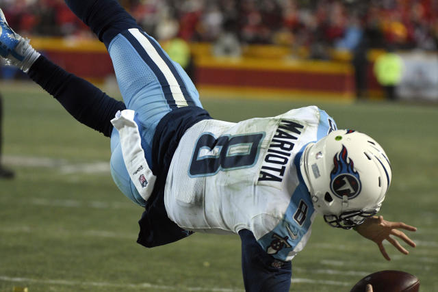 Tennessee Titans quarterback Marcus Mariota (8) leaps over the goal line for a touchdown against the Chiefs. (AP)