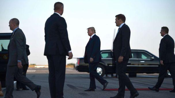 PHOTO: US President Donald Trump walks towards the Presidential car upon arrival at Helsinki-Vantaa Airport in Helsinki, July 15, 2018, on the eve of a summit in Helsinki between the US President and his Russian counterpart. (Brendan Smialowski/AFP/Getty Images)