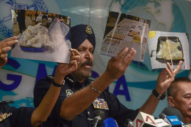 Datuk Seri Amar Singh displays photos of some of the valuables seized in the raids conducted on Datuk Seri Najib Razak's properties, in Kuala Lumpur June 27, 2018. — Picture by Mukhriz Hazim