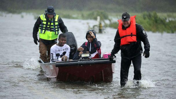 PHOTO: Volunteers from the Civilian Crisis Response Team help rescue three children from their flooded home, Sept. 14, 2018, in James City, N.C. (Chip Somodevilla/Getty Images)