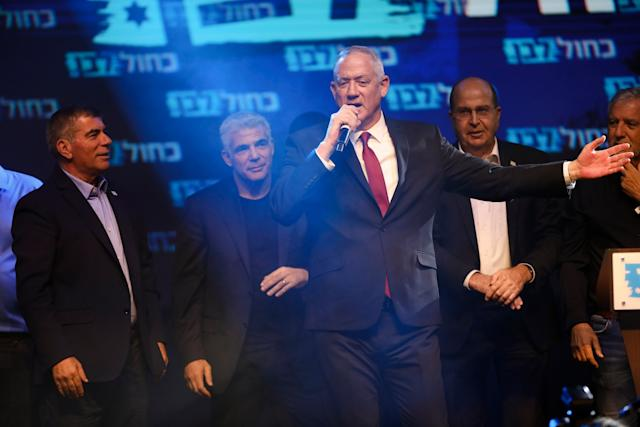 Blue and White party leaders, from the left, Gabi Ashkenazi, Yair Lapid, Benny Gantz and Gabi Ashkenazi. (AP)