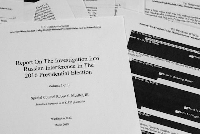 Special Counsel Robert Mueller's redacted report as released on Thursday, April 18, 2019, is photographed in Washington. (AP Photo/Jon Elswick)