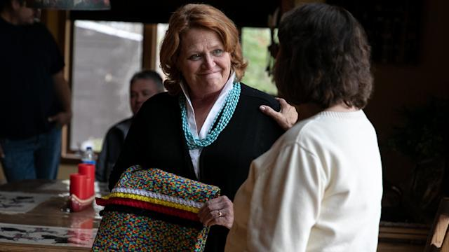 Sen. Heidi Heitkamp (D-N.D.), an underdog in her re-election bid, accepts a ribbon skirt at the home of Twila Martin-Kekahbah, a member of the Turtle Mountain Band of Chippewa.