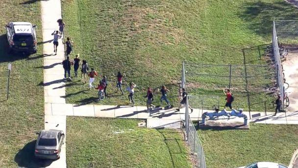 PHOTO: Students are evacuated from Marjory Stoneman Douglas High School after a shooting in Parkland, Fla., Feb. 14, 2018. (WPLG)