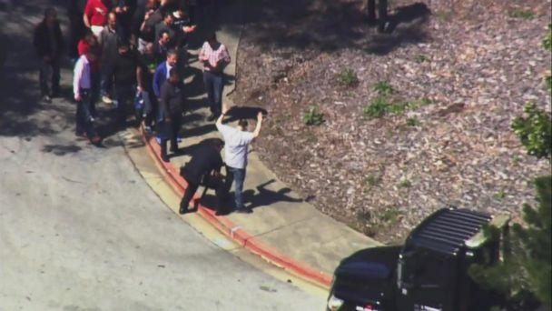 PHOTO: Police officers seen patting down people outside after they exited YouTube headquarters in San Bruno, California, after reports of an active shooter. (KGO)
