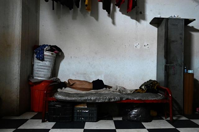 Venezuelan Carlos Daniel Herrera, 23, who suffers psychiatric problems and severe malnutrition rests at the Jehova Gire shelter, a half-done building of the judiciary in Petare neighborhood, Caracas on May 19, 2019. - Symbol of squatting since the time of the late Venezuelan President Hugo Chavez (1999-2013), the concrete skeleton is the home of indigents, victims of disasters and others who fell in disgrace with the worst economic crisis in the recent history of the oil-producing country. (Photo by MARVIN RECINOS / AFP) (Photo credit should read MARVIN RECINOS/AFP/Getty Images)