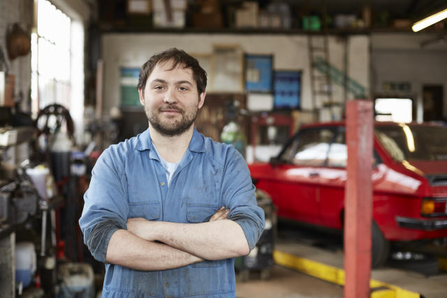 Portrait of junior car mechanic