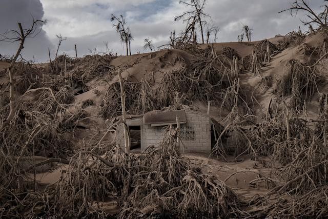 A house near the crater is buried in ash. | Ezra Acayan—Getty Images