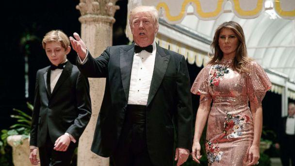 PHOTO: President Donald Trump, first lady Melania Trump, and their son Barron arrive for a New Year's Eve gala at his Mar-a-Lago resort , Dec. 31, 2017, in Palm Beach, Fla. (Evan Vucci/AP)