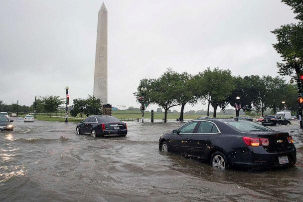 PHOTO: Heavy rainfall flooded the intersection of 15th Street and Constitution Ave., NW stalling cars in the street, on July 8, 2019, in Washington near the Washington Monument. (Alex Brandon/AP)