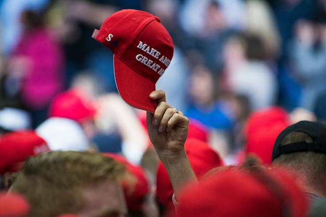 GRAND RAPIDS, MICHIGAN - March 28, 2019: A supporter waves a MAGA hat before a rally for President Donald Trump in Grand Rapids Mich., on March 28, 2019. (Photo by Brittany Greeson/The Washington Post via Getty Images)