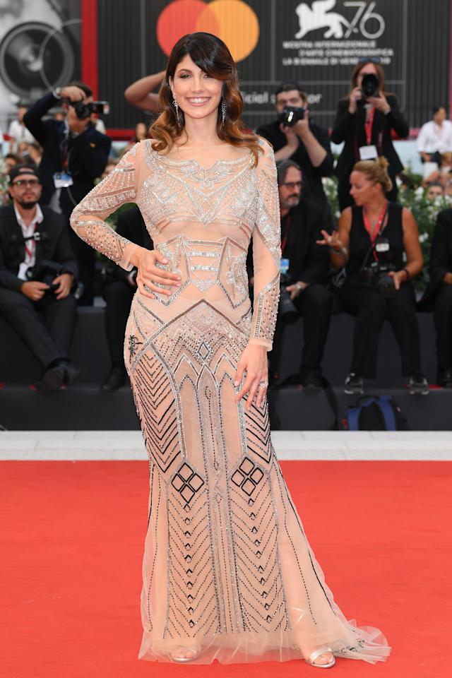 Giorgia Lucini walks the red carpet ahead at the Martin Eden screening. Photo: Getty