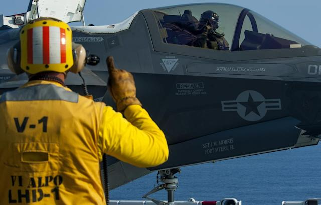 PACIFIC OCEAN (July 17, 2018) Aviation Boatswain's Mate (Handling) 2nd Class James Spencer signals the pilot of an F-35B Lightning II aircraft