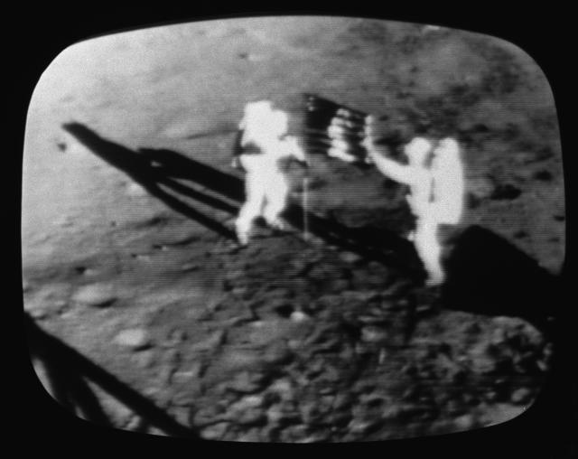A television screen grab from a CBS News Special Report: shows the Apollo 11 astronauts on the moon, July 1969. (Photo by CBS Photo Archive/Getty Images)