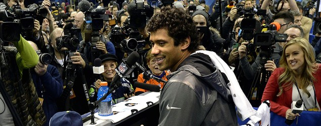Russell Wilson answers questions at Super Bowl Media Day. (Getty Images)