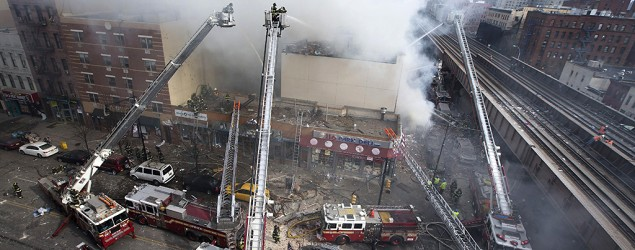 Partial building collapse and fire in New York City (John Minchillo/AP)