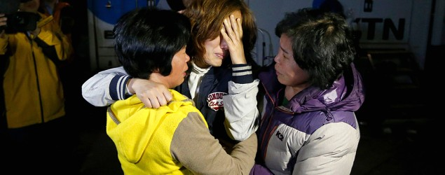 Family members anxiously wait for rescue crews to find missing passengers from a South Korean ferry that sank off the coast. (Reuters)