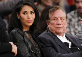 FILE - In this Dec. 19, 2010, file photo, Los Angeles Clippers owner Donald Sterling, right, and V. Stiviano, left, watch the Clippers play the Los Angeles...