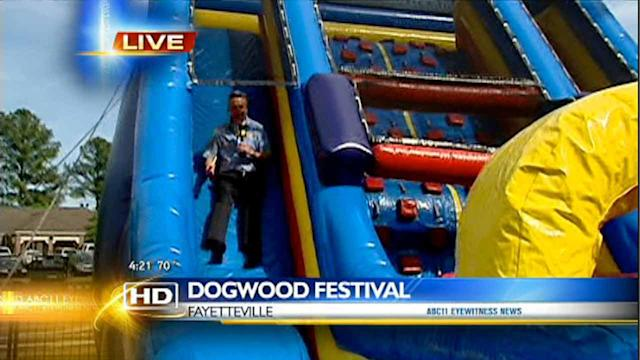 Chris Hohmann tries out slide at Dogwood Festival