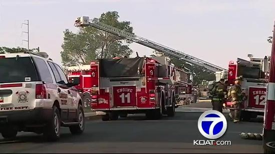Officer injured rescuing baby from burning homes
