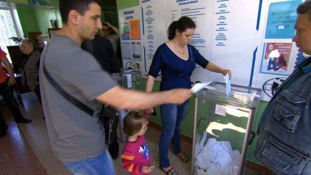 Violence flares in Ukraine, as voters head to polls